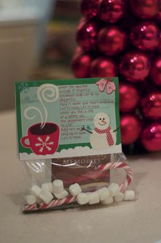 An adorable hot cocoa poem with the addition of mini marshmallows and a candy cane stirrer. Yum, DLW