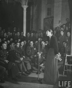 London's Nightlife during Wartime, 1944 - Soldiers crowding inside a Red Cross club, the Hans Crescent Club to listen to singer Joyce Grenfell.