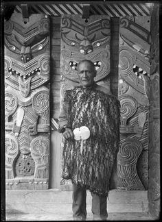Chief Whatanui standing inside the porch at Hinenuitepo meeting house at Te Whaiti, 1930