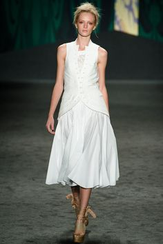 """Opening statement of white cotton voile & canvas, especially liked as sleeveless cut away jacket (vest) over wrap dress with flared dancing skirt."" Vera Wang Spring 2013 RTW"