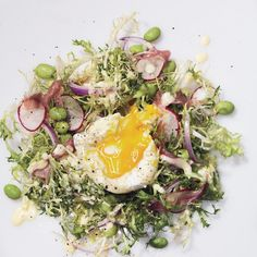 It's the classic brunch dish—in salad form. Frisée, edamame, radishes,         and red onions are sprinkled with         prosciutto, then topped with a poached         egg and hollandaise.