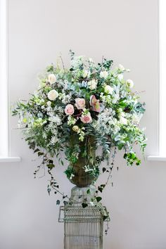 Floral wedding centerpiece. Roses, ivy, gypsophilia and much much more. Arranged in a wire, birdcage-esque vase. Flowers by Selina Godsal. Iscoyd Park Wedding.  ©TonyHartPhoto  iscoydpark_wedding_sf-006