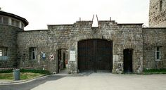Photos of the main entrance to Mauthausen Concentration Camp Main Entrance, Entrance Doors, Exterior Doors, Interior And Exterior, Big Houses, Door Signs, Double Doors, Building Design, Prison