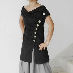 I love the shape of this and the buttons.  Could be a great shape for a knitted garment
