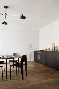 Reform's Norm Architects kitchen design in sawn smoked oak, bronzed tombac handles and countertop in solid smoked oak.