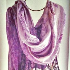Purple Metallic Wrap w Fringe End This wrap is so versatile, whether over a dress or rocking jeans, this is ideal. Scarf necklace sold separately. Accessories Scarves & Wraps