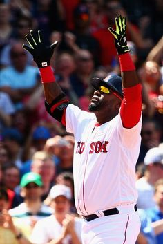 MAY 14: David Ortiz #34 of the Boston Red Sox celebrates after hitting a home run against the Houston Astros during the third inning on May 14, 2016 in Boston, Massachusetts.