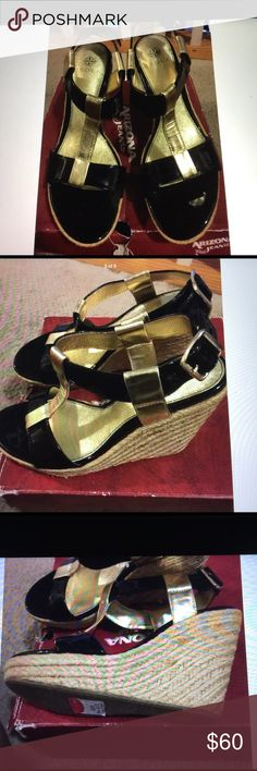 """Idols Olencia blk/gold patent leather Espadrilles Snappy patent sassy T strap sandal set on a jute wrapped wedge for warm weather chic. Adjustable strap, approximate heel 4.5"""" with 1 1/4"""" platform. Originally $159.95 plus tax. Has some satins on the Espadrilles, bought from store like that. Not really noticeable except when you look really close. Isola Shoes Espadrilles"""