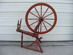 """antique spinning wheel with a 27"""" wheel may not be complete but would be a great country decorator piece and stands 42"""" high.  Price $ 225  Sale Price $ 175"""