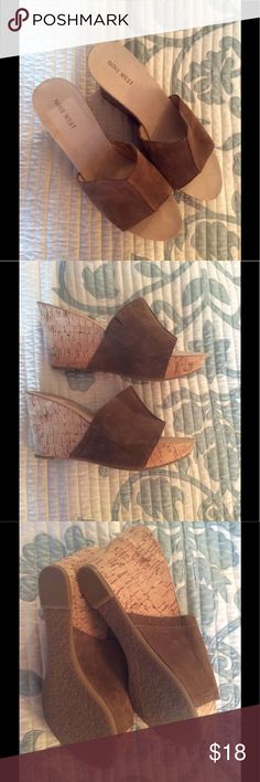 Nine West suede and cork wedge sandals. Never worn.  Suede leather upper.  4 inches in height.  Cork bottom.  Super comfortable.  No box.  On the inside of the right shoe, you can see the rectangle where the price tag was located. Nine West Shoes Wedges