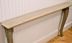 two recycled table legs and a wall shelf become a narrow wall or sofa table