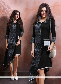 Add richer looks to your persona in this black cotton   and rayon party wear kurti. The print work looks chic and perfect for party. (Slight variation in color, fabric & work is possible. Model images...