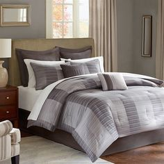 The Tribeca collection features contemporary modern look for any room. This 12 piece comforter set includes everything that you need to complete your bed. The comforter and shams features a jacquard pattern that is woven into strie stripes that form a colorblock stripe pattern. This pattern is in cool greys that is perfect for any modern room. The Euro shams and bedskirt are made of ultra soft brushed polyester in solid grey. The set also comes with a 4 piece crisp white brushed polyester…