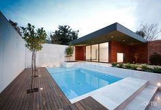 OFTB Melbourne landscaping, pool design & construction project - retreat inc. sliding doors & viewing window, pool inc. water wall, L-shaped lounge, bbq/dining table, service area inc. toilet, garden beds