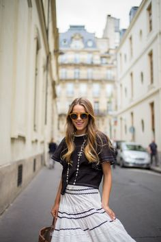 Chanel necklace, black top and white skirt