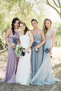 Have each bridesmaid pick out a long gown in light blue or light purple organza and pair it with a bouquet of lavender. Or go for glitz and glam with sequins and gold!