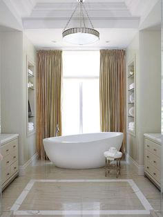 Mixing Styles: Classic Meets Contemporary! I am not a tub lady but I have close friends who love to bath! I guess I could sit in this one for a spell