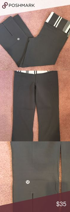 Lululemon yoga capris Dark grey lululemon yoga capris with striped detail on waistband and split back. Slight pilling on back (shown in pics).  Bundle with other items! lululemon athletica Pants Capris