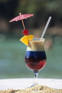 Every luxe trip to Jamaica includes an umbrella drink on the beach!  #CCLuxe cheapcaribbean.com