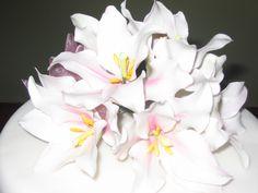 White Wedding Cake Icing Flower Arrangement