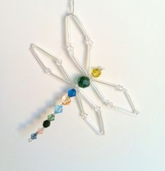 Custom Dragonfly Sun Catcher - Swarovski Crystal and glass beaded dragonfly suncatcher gift for bug lover. $15.00, via Etsy.