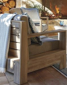 Wide-plank geometric angles and clean lines mark the captivating St. Kitts Seating.   Frontgate: Live Beautifully Outdoors