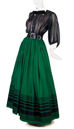 Jacques Fath Silk Two-Piece Evening Dress, French, 1950/51  Comprising a black crystal pleated silk voile blouse with set in full elbow length sleeves, black buttons at front closure, black velvet ribbon sewn bow at neck, removable ivory cotton collar and cuffs, an emerald silk faille floor length skirt