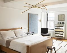 Featured works, from left to right: Billy Cotton chandelier, Robert Stilin bed, Meier/Ferrer nightstand, Mark Hagen painting, Robert Stilin sconce, vintage '50s chaise, Louis Pons cabinet.