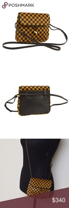 """Authentic Louis Vuitton Gazelle Pony Fur Bag Subtly crafted of smooth pony hair in the signature damier check pattern, this mini cross body pochette is ideal for just the essentials. The flap features dangling brass LV cubes and opens to a compact microsuede interior. This stylish bag will take you effortlessly from daily errands to an evening out, with the look of Louis Vuitton! 6'x6"""". scuffs on leather, interior wear, missing fur. Louis Vuitton Bags Shoulder Bags"""
