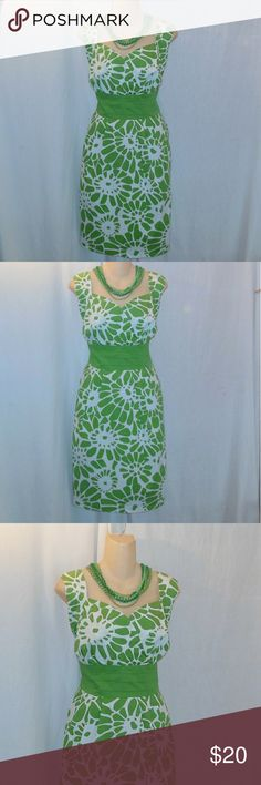 Ashley Stewart  Floral Sleeveless Midi Dress Sz 20 Up for your consideration here is a green and white floral pattern dress made by Ashley Steward in a size 20. It is sleeveless with cap sleeves. This dress is in good used condition however it is a bit faded in the 5th phtograph you can see that it has a partial zipper closure on the side. Make sure to browse the rest of my closet and choose another item, place them both into a bundle for 10% off at least :-) Ashley Stewart Dresses Midi