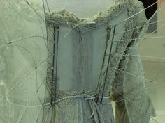 Ever After wing attachment - notice the button hole at the tope of the bodice where the wings attach to the dress.