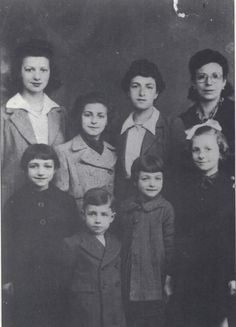 Germaine Arrovas *little girl on second right* deported with her family on Oct. 26, 1943.