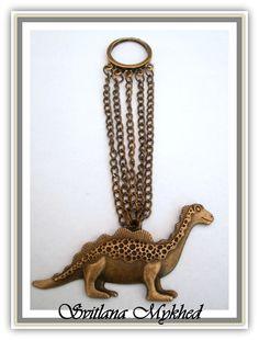 Pendentif `Dinosaure` . Métal bronze. création unique : Pendentif par perles-et-couronnes
