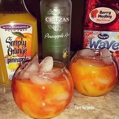 TROPICAL FUSION 2 oz. (60ml) Pineapple Rum 3 oz. (60ml) Pineapple Orange Juice 2 oz. (60ml) Cranberry Juice 1 oz. (30ml) Grenadine  Tipsy Bartender