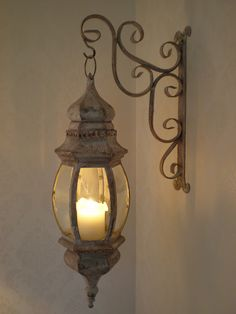LANTERN: on Lacey Wrought Iron Holder. More