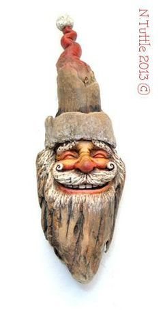 """""""Woodland Santa""""   This jolly old elf of Christmas measures a hair over  8 inches tall and 2½ inches across his widest point.     Signed and dated:  N. Tuttle 12/1/13"""