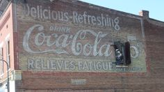 Old coke sign painted on a building in Guthrie, KY.