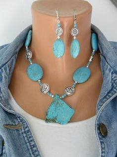 Turquoise Southwestern Style semi Precious Stone Statement Necklace and Earring set, This is my latest creation ,oval puffed stabilized Turquoise 32 mm x 24 mm with metal rhodium plated Fleur De Lis ,silver plated ball beads and 4 mm Turquoise Breads rhodium chain with Lobster claw closure,Pende...