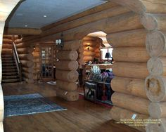 The main hall in a handcrafted lakefront home in Ontario. The hall is designed to be able to seat thirty plus people for large gatherings.  #loghomes #loghomedesign #handcraftedlog #lakefront  For more photos of this or more of my designs, please check out my website, www.designma.com, my Design Page, www.facebook.com/loghomedesign — in Penetanguishene, Ontario.