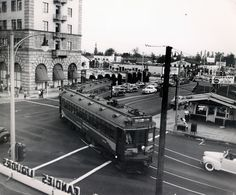 (10/7/1950) Pacific Electric Railway Car No. 1221 on the Pasadena via Oak Knoll Line turning west onto Colorado Street from Lake Avenue. This line was abandoned the following day.