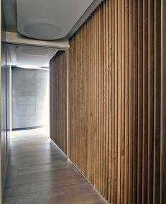 Dynamic Loft Warehouse Style Apartment warmth white oak fin wall floor cladding