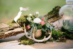 Branches or logs with moss could be used to provide a backdrop to smaller table arrangements. The antler bones could be used or not and replaced with crystals, shells, flowers etc. or just let the ceramic stand alone.