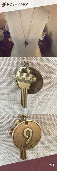 Bates Motel long bronzed key necklace This is a long necklace with a fake key and motel room number tag. Inspired by the tv show Bates Motel. Out of package but never worn. Hot Topic Jewelry Necklaces