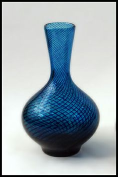 Hadeland, Norway  Handblown glass vase in blue glass, internally decorated with spiral threads of darker blue glass.