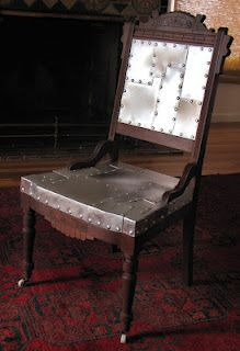 Upcycled - an antique Victorian Eastlake chair now has a cool industrial flair.