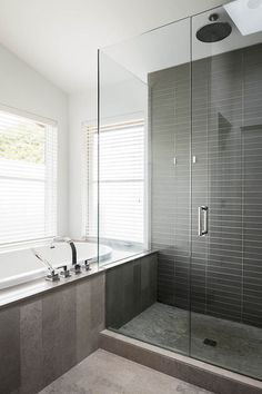 If you opt for medium or dark gray wall and floor tiles, try selecting tiles of different sizes, shapes and shades to keep them from looking monolithic and overbearing. Also, these tiles are in a warmer shade of gray — heading toward taupe. They make for a nice neutral background that isn't too cold.