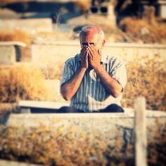 A Palestinian man prays over her son's grave at the Islamic cemetery in Gaza city on the first day of Eid al- Fitr Thursday july. 17 2015. The three-day Eid al-Fitr festival marks the end of the Muslim holy month of Ramadan and during the first day of the feast it is a tradition to visit the graves of loved ones.. #eid_alfitr #shot #daily_life #daily_life_gaza #gaza #art #every_day_gaza #photo #pic #freegaza #freepalestine #palestine #refugee #ajagaza  by : @abdallah_jadallah by…
