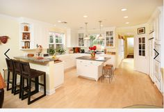 Maple floors and white cabinets