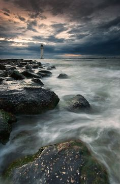 *lighthouse.I want to go see this place one day.Please check out my website thanks. www.photopix.co.nz