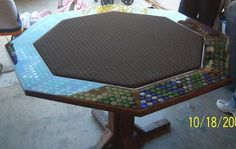 My BF would love this bottle cap poker table!